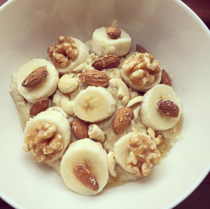 White chocolate protein oats cooked with rice milk. Topped with banana, mixed nuts and some honey